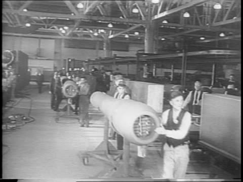 stockvideo's en b-roll-footage met women in toledo factory work on robot bombs using unexploded nazi v1 parts / animation of new bomb / workers in dearborn weld parts of bomb /... - raket wapen