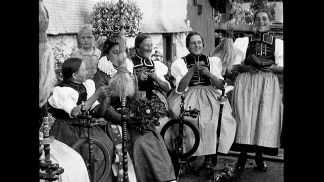 women in traditional austrian dress in a small village travelogue of danube river on january 01 1938 in austria - österreichische kultur stock-videos und b-roll-filmmaterial