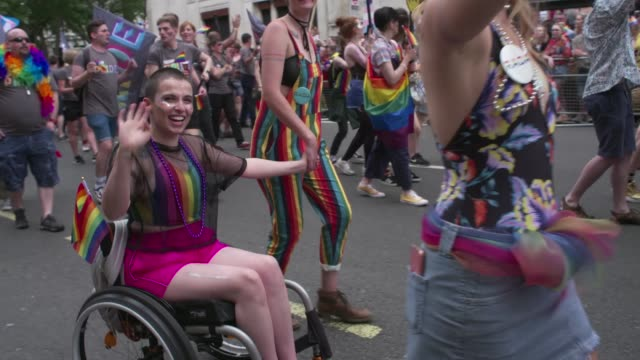 women in wheelchair people dancing rainbow flags rainbow balloons at atmosphere general views at pride in london 2019 on july 06 2019 in london... - dancing stock videos & royalty-free footage