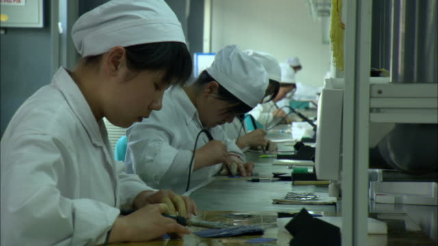 ms women in white coats soldering parts used to make solar hot water heaters, dezhou, shandong, china - conformity stock videos & royalty-free footage