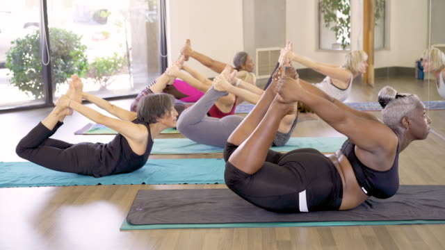 women in yoga class - long beach california stock videos & royalty-free footage