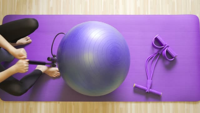 women inflate yoga balls - fitness ball stock videos & royalty-free footage