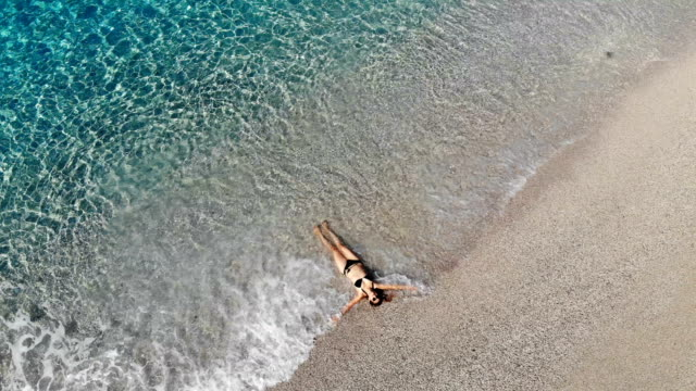 women is enjoying the waves. - oludeniz stock videos and b-roll footage