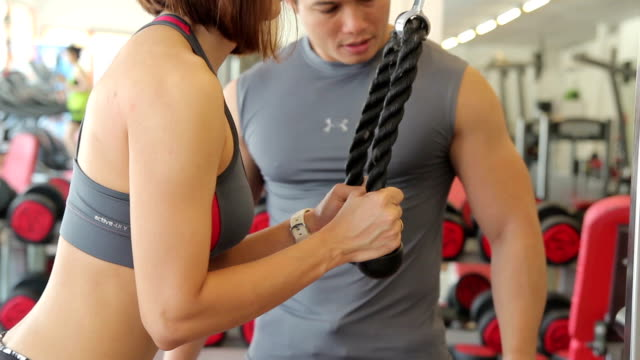 women is exercising with trainer - bicep stock videos & royalty-free footage