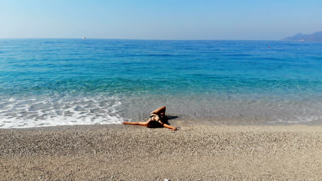 women is having fun at the beach. - oludeniz stock videos and b-roll footage