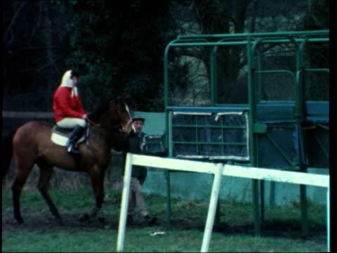 women jockeys; england: scott i/c brooke sanders on horse into starting gate and the riding brooke sanders interview sot horses training brian swift... - jockey stock videos & royalty-free footage