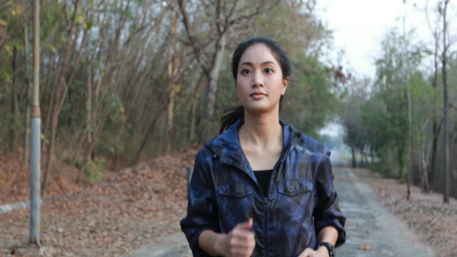women jogging and runners legs. - fitness tracker stock videos and b-roll footage