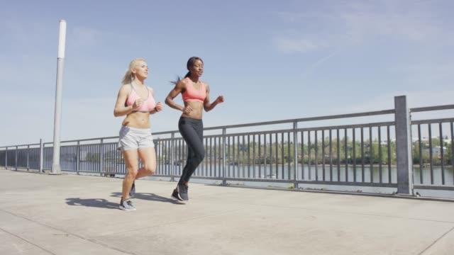 Women Jogging in Sports Bras