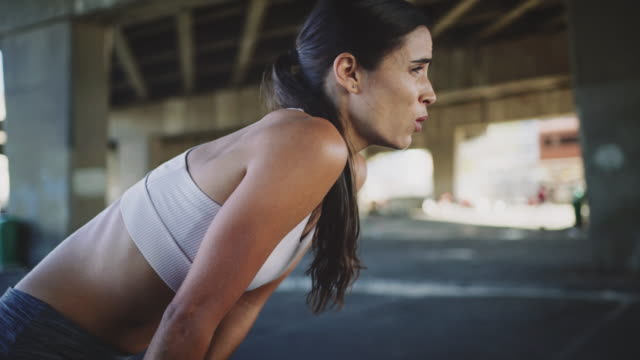 women jogging looking at smartwatch - instrument of time stock videos & royalty-free footage