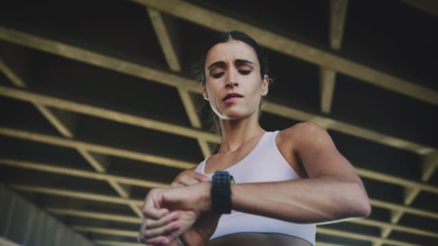 women jogging looking at smartwatch - smart watch stock videos & royalty-free footage