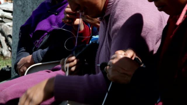 "women knitting in salinas de guaranda, ""paramo"" (upland), ecuador - jumper stock videos & royalty-free footage"