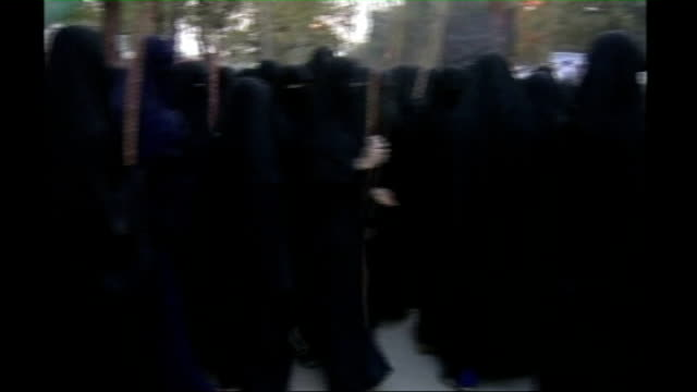 women launch mini jihad in islamabad madrassa; ext female school children armed with sticks protesting and chanting outside school building female... - confession law stock videos & royalty-free footage