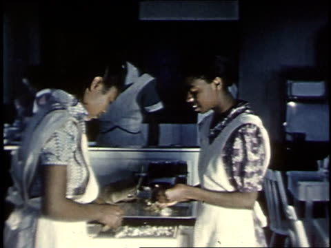 vidéos et rushes de 1940 montage women learning to prepare and serve meals / boligee, alabama, united states - 1940