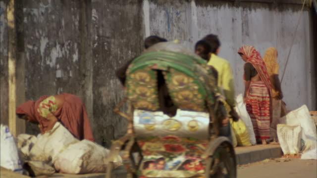 ms, women lifting heavy sacks on sidewalk on street, dhaka, bangladesh - dhaka stock videos and b-roll footage