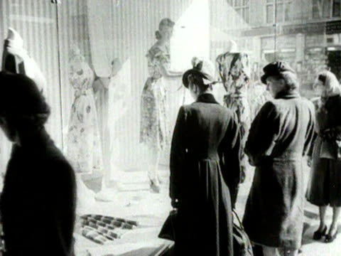 women look at dresses displayed in a shop window 1954 - food stamps stock videos & royalty-free footage