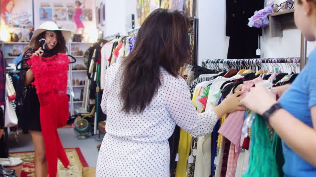 Women Looking at Clothes in Vintage Store