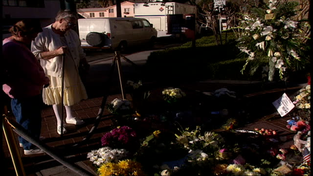 Women Looking at Flowers Left at Sonny Bono Memorial in Palm Springs California
