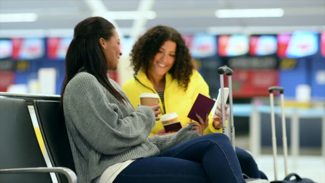 women looking at passport - engångsmugg bildbanksvideor och videomaterial från bakom kulisserna