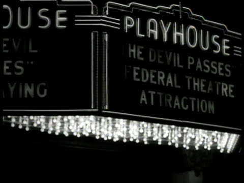 women looking at photograph collage in theatre lobby ext ms wpa canopy marquee 'playhouse the devil passes federal theatre' int ms board sign... - playhouse stock videos & royalty-free footage