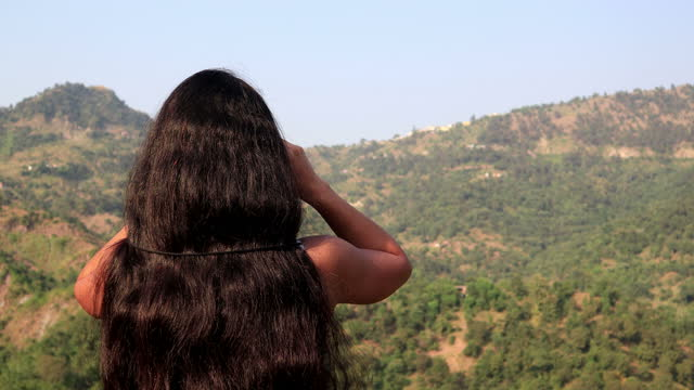 women looking through binocular in mountains - black hair stock videos & royalty-free footage