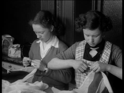 women making flags in liverpool factory in preparation for coronation of queen elizabeth ii jan 53 - coronation stock videos and b-roll footage
