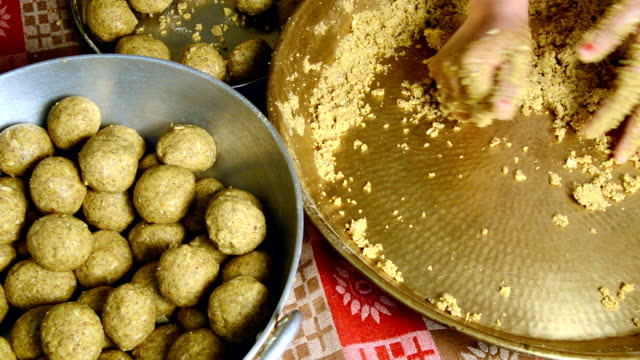 women making laddu of besan - snack stock videos and b-roll footage