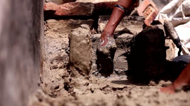 Women making mud stove