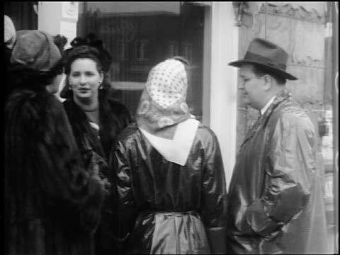b/w 1944 3 women + man in coats talking on sidewalk / lexington, nc / documentary - 1944 stock videos and b-roll footage