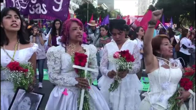 vídeos de stock e filmes b-roll de women march through the streets of the mexican capital some dressed in bridal outfits others carrying pink crosses on the un designated international... - violência