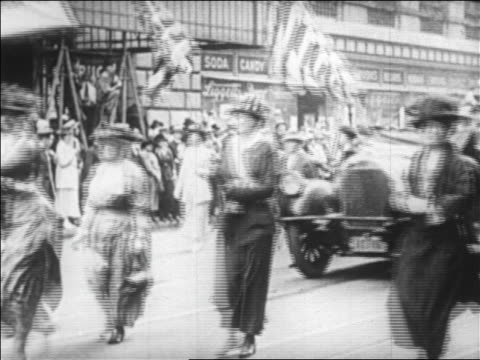 b/w 1920 women marching car on street at suffragette victory parade / boston / newsreel - voting rights stock videos & royalty-free footage