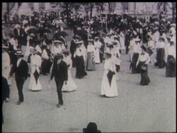 women + men walking in women's suffrage parade at st. louis world's fair - frauenrechte stock-videos und b-roll-filmmaterial