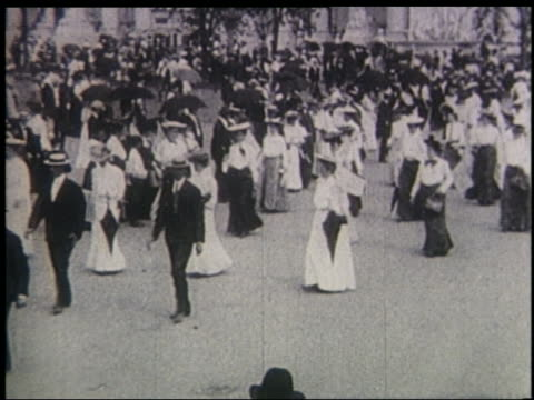 b/w 1904 women men walking in women's suffrage parade at st louis world's fair - exhibition stock videos & royalty-free footage