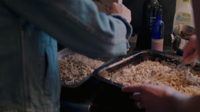 women mixing ingredients for muesli/granola - baking sheet stock videos & royalty-free footage