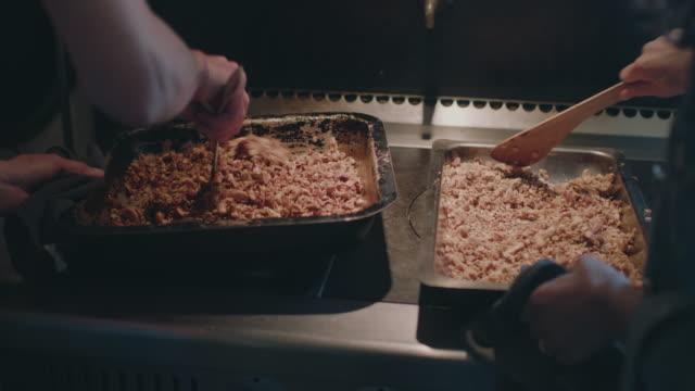 women mixing ingredients/baked granola - baking sheet stock videos & royalty-free footage