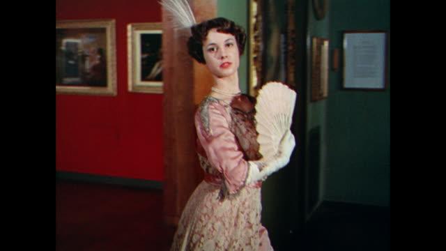 ws women model floor length gowns in an art gallery / uk - floor length stock videos & royalty-free footage