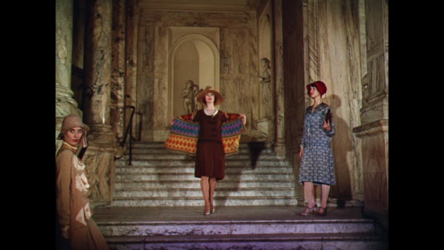 ws women model made to order dresses on a grand staircase / uk - 既製服点の映像素材/bロール