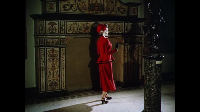 vídeos y material grabado en eventos de stock de montage women model modern british styles in front of a hearth / uk - vestido tubo