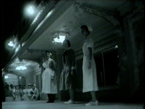 women model nurses uniforms at a banquet in chicago in 1959 - 1959 stock videos & royalty-free footage