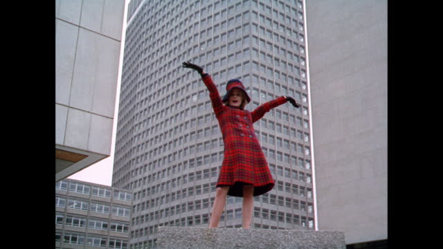 MONTAGE Women model plaid outfits at modern buildings / UK
