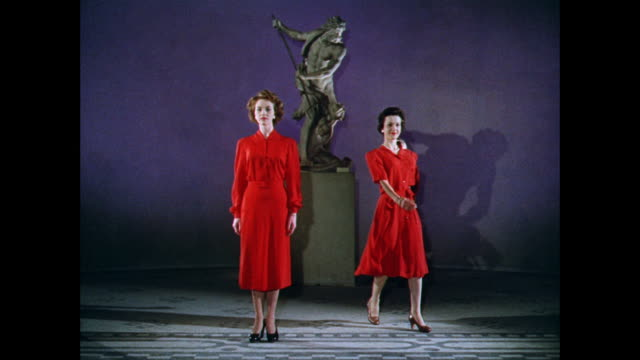 WS Women model red collar dresses in front of a sculpture / UK
