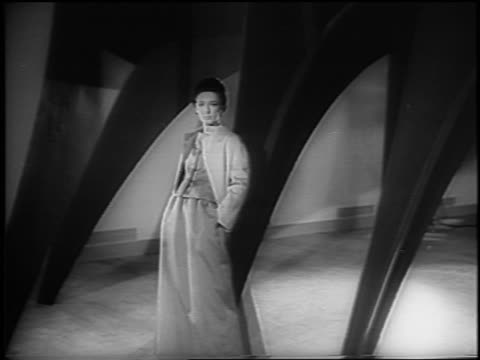 b/w 1965 women modeling formalwear appearing posed by sculpture / moma / nyc / newsreel - anno 1965 video stock e b–roll