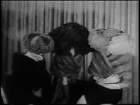 B/W 1956 3 women modelling hats made of velvet + ostrich feathers + fox fur / newsreel