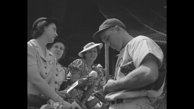women move in line to buy baseball tickets at polo grounds / women pass through gate into stadium / two women buy game programs from vendor / women... - inning stock videos & royalty-free footage