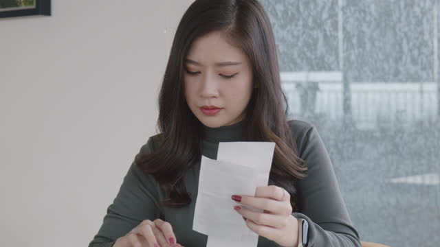 women of asian descent aged 20-30 work and calculate financial figures at a home office. - file clerk stock videos & royalty-free footage