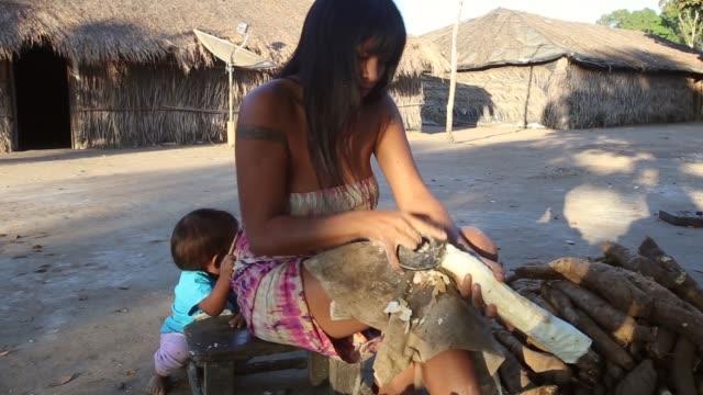 MS Women of Kamayura village prepare Manioc shot on June 14th 2014