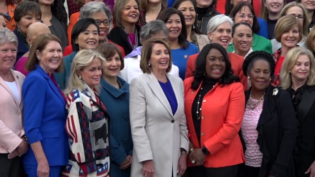 women of the house democratic caucus pose for media and press on the east front plaza of the us capitol building a day after opening of the 116th... - hill点の映像素材/bロール