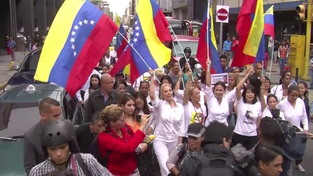 Women of the Venezuelan opposition wives of what they describe as political prisoners and legislators march against the government of President...