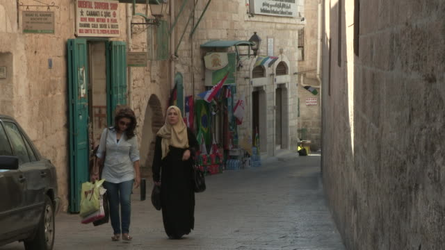 women on a narrow road, bethlehem, palestine - narrow stock videos & royalty-free footage