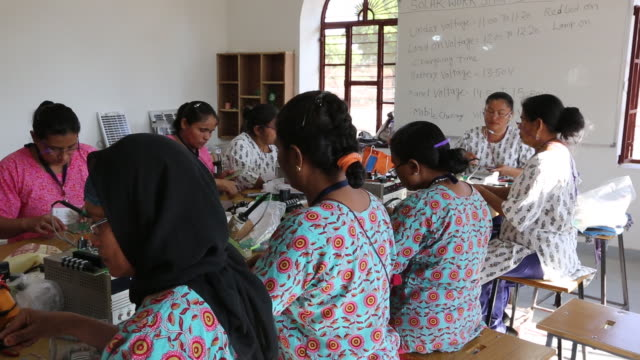 Women on a solar workshop, learning how to make so