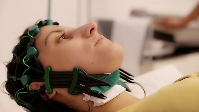 Women on EEG examination in clinic,close up